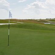 Op zondag 1 juli 2012 is de nieuwe golfbaan The International (Amsterdam Airport) geopend. Deze is gelegen tussen Schiphol, de A9 en de A10.Via een gerechtelijke procedure moest de oude naam (Amsterdam International - Golfclub Schiphol) worden gewijzigd in The International, omdat de (oude) naam veel verwarring schepte met overige Amsterdamse golfclubs.Topgolfer Ian Woosnam (Ryder Cup Captain en US Masters winnaar) heeft in samenwerking met Mastergolf de baan van The International ontworpen. Het design maakt gebruik van het geaccidenteerde terrein. Hoogteverschillen tot 14 meter, waterpartijen, unieke perspectieven en prachtige zichtlijnen. Foto JOVIP/JOHN VAN IPEREN