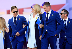 Team Europe's Thorbjorn Olesen (left) with Ian Poulter and Katie Poulter during the opening ceremony of the Ryder Cup at Le Golf National, Saint-Quentin-en-Yvelines, Paris.