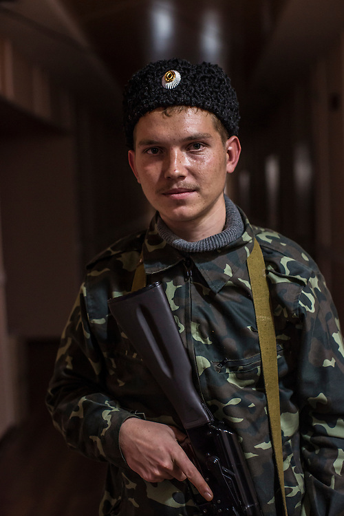 PERVOMAISK, UKRAINE - NOVEMBER 20, 2014: Petr Khokhlov, a member of the First Cossack Regiment Named Platov of the Great Don Army, poses for a portrait at the dormitory where he is stationed in Pervomaisk, Ukraine. CREDIT: Brendan Hoffman for The New York Times