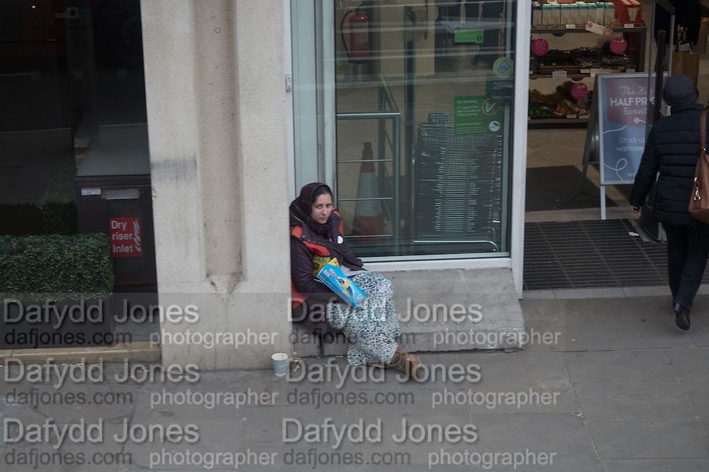 Begging Outside Waitrose, Kensington High St. Homeless, begging,  The Strand, London. 28 January 2016