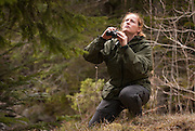 Woman bird watching with field glasses, Mercantour National Park, France