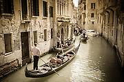 Gondolas on a busy canal, Venice, Veneto, Italy