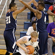 Hoggard's Blake Donnelly is defended by Millbrok's Rha'Kwon Bryant, left and Faison Brock. (Jason A. Frizzelle)
