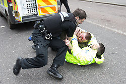 © Licensed to London News Pictures . 28/02/2015 . Newcastle , UK . A man in handcuffs with blood on his face fights with police in the middle of Newgate Street after earlier being heard making EDL chants at the Pegida demonstration . Hundreds attend the first Pegida demonstration in the UK , at the Bigg Market in Newcastle . Photo credit : Joel Goodman/LNP