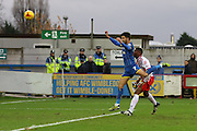 George Francomb of AFC Wimbledon beats Jerome Okimo of Stevenage during the Sky Bet League 2 match between AFC Wimbledon and Stevenage at the Cherry Red Records Stadium, Kingston, England on 12 December 2015. Photo by Stuart Butcher.
