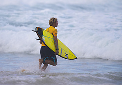 December 11, 2017 - Banzai Pipeline, HI, USA - BANZAI PIPELINE, HI - DECEMBER 11, 2017 - John John Florence of Hawaii runs out for his heat in the first round of the Billabong Pipe Masters. (Credit Image: © Erich Schlegel via ZUMA Wire)