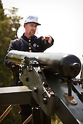 Confederate re-enactors man a 6-inch canon aimed at Fort Sumter in Charleston Harbor Charleston, SC. The re-enactors are part of the 150th commemoration of the US Civil War.