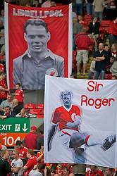 """LIVERPOOL, ENGLAND - Saturday, April 23, 2011: Liverpool's supporters on the Spion Kop display banners celebrating former heroes Billy Liddell and """"Sir"""" Roger Hunt before the Premiership match against Birmingham City at Anfield. (Photo by David Rawcliffe/Propaganda)"""