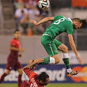 David Meyler, Ireland, is tackled by Hugo Almeida, Portugal, during the Portugal V Ireland International Friendly match in preparation for the 2014 FIFA World Cup in Brazil. MetLife Stadium, Rutherford, New Jersey, USA. 10th June 2014. Photo Tim Clayton