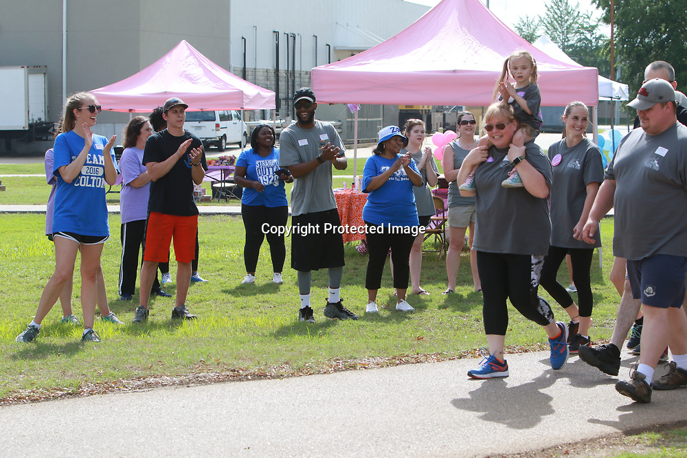 LIBBY EZELL | BUY AT PHOTOS.DJOURNAL.COM<br /> The crowd at Saturday's March of Dimes cheers on the walkers during their lap around the NMMC Walking Track