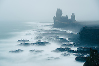 Lóndrangar Sea Stack in fog. Snæfellsnes Peninsula, West Iceland.