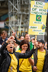 © Licensed to London News Pictures. 07/10/2018. LONDON, UK. Supporters of far-right candidate Jair Bolsonaro demonstrate as Brazilians in London queue to cast their vote at the Embassy of Brazil near Trafalgar Square, for the Brazilian Presidential elections.  Far-right candidate Jair Bolsonaro is the front runner against left-wing candidate for the Workers' Party, Fernando Haddad. Photo credit: Stephen Chung/LNP