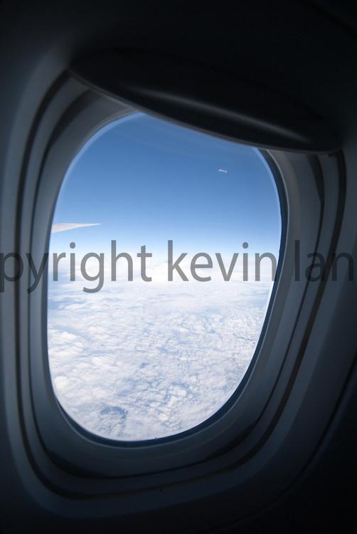 airplane window sky while flying between albuquerque, new mexico, and houston texas enroute to rio de janeiro brazil.