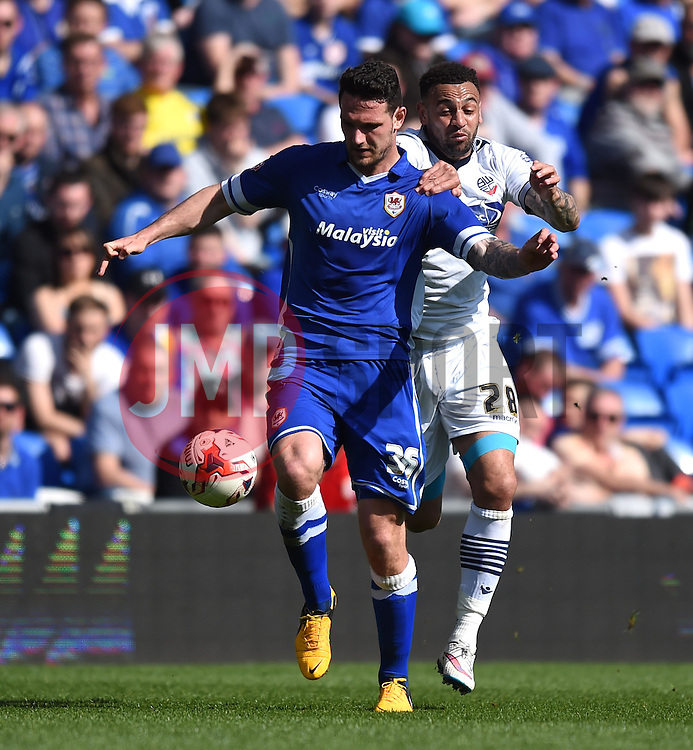 Cardiff City's Sean Morrison shields the ball from Bolton Wanderers' Craig Davies - Photo mandatory by-line: Paul Knight/JMP - Mobile: 07966 386802 - 06/04/2015 - SPORT - Football - Cardiff - Cardiff City Stadium - Cardiff City v Bolton Wanderers - Sky Bet Championship