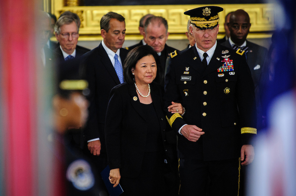 IRENE HIRANO INOUYE is escorted to pay her respects to her husband in the Capitol Rotunda on Thursday during a service and public viewing of the late Senator Daniel Inouye (D-HI) who passed away at the age of 88 on December 18 at the Walter Reed National Military Medical Center in Bethesda, Md. Inouye, 88, a decorated World War II veteran and the second-longest serving senator in history will lie in state until Friday when a memorial service will be held at the National Cathedral.