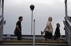 © Licensed to London News Pictures. 06/09/2013<br /> A grey and overcase start to the day for London commuters this morning (06.09.2013). Armed with their umbrellas commuters at Pettswood train station in Greater London near Bromley looked to be missing the sun already.<br /> Photo credit :Grant Falvey/LNP
