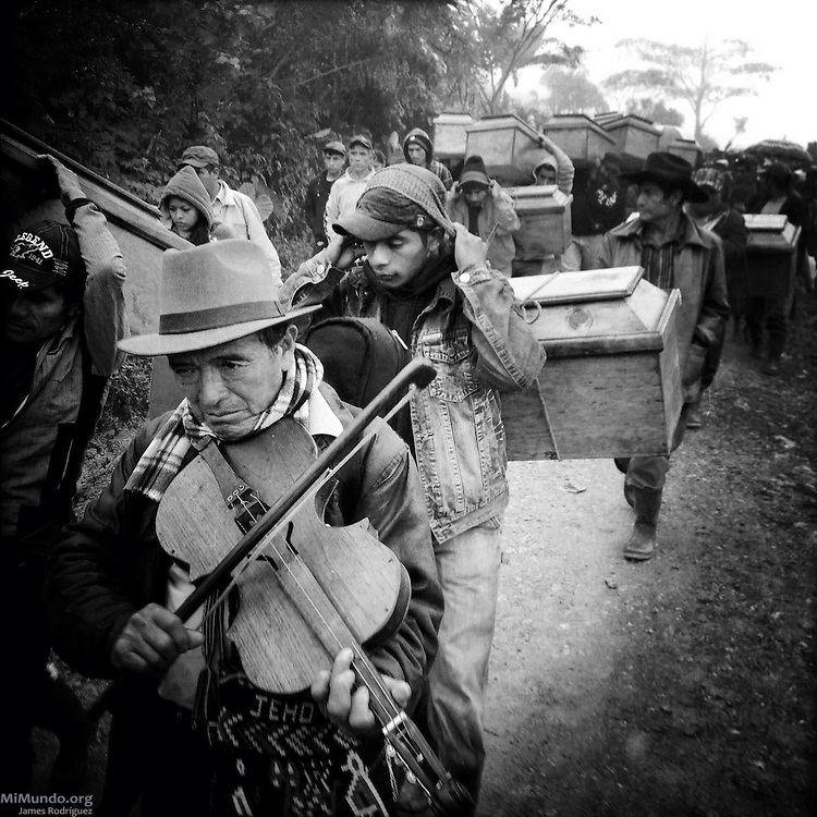 Residents of Covadonga and Estrella Polar bury the skeletal remains and fragments of 77 people massacred on March 29, 1982, in Covadonga and posthumously exhumed from a mass grave in September 2009. Estrella Polar, Chajul, Quiche, Guatemala. November 20, 2014.