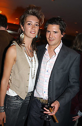 SOPHIA ROGGE and EDWARD TAYLOR at a night of Cuban Cocktails and Cabaret hosted by Edward Taylor and Charles Beamish at Floridita, 100 Wardour Street, London W1 on 14th April 2005.<br />