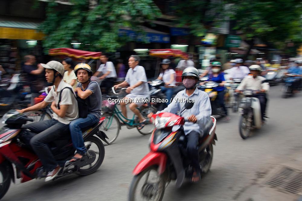 motorbike traffic.<br /> Hanoi, Vietnam.