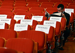 © Licensed to London News Pictures. 10/10/2012. Birmingham, UK  A man reads a newspaper amongst reserved seating ahead of the Prime Minster's speech at The Conservative Party Conference at the ICC today 10th October 2012. Photo credit : Stephen Simpson/LNP