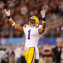 Jan 7, 2011; Arlington, TX, USA; LSU Tigers cornerback Eric Reid (1) pumps in the crowd during the 2011 Cotton Bowl against the Texas A&M Aggies at Cowboys Stadium.  Mandatory Credit: Derick E. Hingle