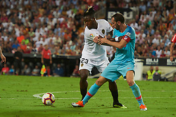 August 20, 2018 - Valencia, U.S. - VALENCIA, SPAIN  - AUGUST 20:  Michy  batshuayi forward of Valencia cf competes for the ball with Diego Godin defender of Atletico de Madrid during the La Liga between Valencia CF and Atletico de Madrid on August 20, 2018 at Mestalla in Valencia, Spain. (Photo by Carlos Sanchez Martinez/Icon Sportswire) (Credit Image: © Carlos Sanchez Martinez/Icon SMI via ZUMA Press)