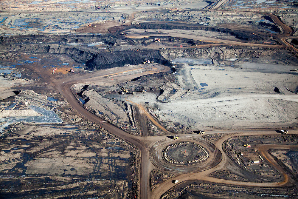 Trucks at tar sands mines carry loads of up 400 tons and cost approximately $5-6 million each. Their tires, seen lining the traffic circle at Syncrude Mildred Lake, have a diameter of 13 feet, weigh more than 15 tons, have a lifespan of 12 to 15 months, and cost about $50,000 each.