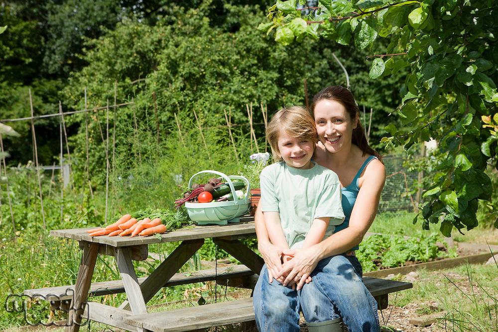 Mother sitting with son in garden portrait