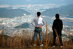 SOUTH KOREA MASAN 28OCT07 - Two Korean youths enjoy the view of the port city of Masan from the hills surrounding Masan, south Korea...jre/Photo by Jiri Rezac..© Jiri Rezac 2007..Contact: +44 (0) 7050 110 417.Mobile:  +44 (0) 7801 337 683.Office:  +44 (0) 20 8968 9635..Email:   jiri@jirirezac.com.Web:    www.jirirezac.com..© All images Jiri Rezac 2007 - All rights reserved.