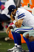 Dallas Cowboys quarterback Tony Romo (9) sits on the sideline bench as he buries his head in his hand on a five interception night during the NFL week 4 football game against the Chicago Bears on Monday, Oct. 1, 2012 in Arlington, Texas. The Bears won the game 34-18. ©Paul Anthony Spinelli
