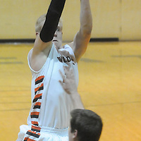 New Hanover's Brian Howell shoots over Ashley's Ryan Keller Friday December 19, 2014 at New Hanover High School in Wilmington, N.C. (Jason A. Frizzelle)