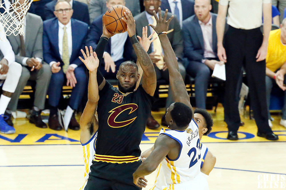 12 June 2017: Cleveland Cavaliers forward LeBron James (23) passes the ball past Golden State Warriors forward Draymond Green (23) during the Golden State Warriors 129-120 victory over the Cleveland Cavaliers, in game 5 of the 2017 NBA Finals, at the Oracle Arena, Oakland, California, USA.