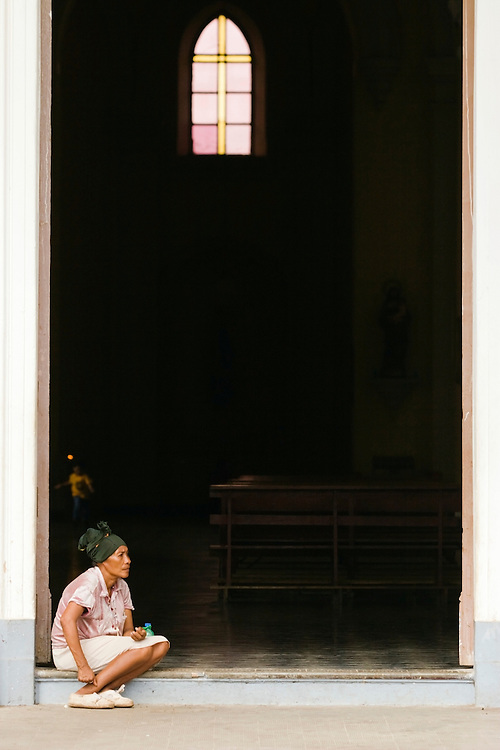 A woman sits in the entrance to the cathedral of Granada, she begs for money money from those coming and going. Life has become much harder under the Sandinista Government of Daniel Ortega