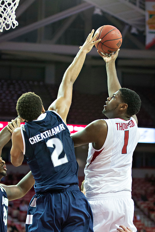FAYETTEVILLE, AR - NOVEMBER 18:  Trey Thompson #1 of the Arkansas Razorbacks shoots over the out stretched arm of Kwan Cheatham Jr. #2 of the Akron Zips at Bud Walton Arena on November 18, 2015 in Fayetteville, Arkansas.  The Zips defeated the Razorbacks 88-80.  (Photo by Wesley Hitt/Getty Images) *** Local Caption *** Trey Thompson; Kwan Cheatham Jr.
