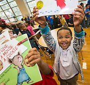 Students select free books provided by the Houston Public Library during a Touchdown Houston Read On literacy program at Ross Elementary School, December 2, 2016.