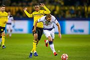 Borussia Dortmund defender Abdou Diallo (4) tackles Tottenham Hotspur forward Harry Kane (10) during the Champions League round of 16, leg 2 of 2 match between Borussia Dortmund and Tottenham Hotspur at Signal Iduna Park, Dortmund, Germany on 5 March 2019.