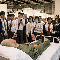 Visitors look artist Shen Shaomin's 'Fidel Castro', part of his 'Summit' project, at Art Basel Hong Kong 2017 on 23 March 2017, in Hong Kong Convention and Exhibition Centre, Hong Kong, China. Photo by Chris Wong / studioEAST