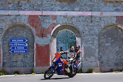 Motorcyclist and passenger on KTM Dakar motorbike on The Stelvio Pass, Passo dello Stelvio, Stilfser Joch, to Bormio, Italy