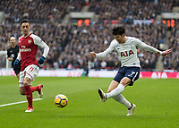 Football - 2017 / 2018 Premier League - Tottenham Hotspur vs. Arsenal<br /> <br /> Heung-Min Son (Tottenham FC)  crosses the ball into the Arsenal goal area at Wembley Stadium.<br /> <br /> COLORSPORT/DANIEL BEARHAM