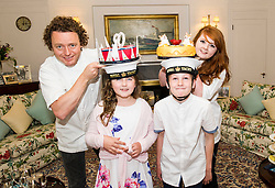Pictured: Tom Kitchin, Lucy Kearney (8), Alfie Bennet (11) and Vicki Tighe<br /> <br /> Chefs Tom Kitchin and Vicki Tighe  presented primary pupils Alfie Bennet and Lucy Kearney with nine-inch versions of their winning entries for the &quot;Design a Cake for The Queen's 90th Birthday&quot; competition o the Royal Yacht Britannia today. <br /> Ger Harley | EEm 10 June 2016