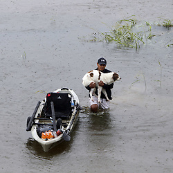 Aug 27, 2017 - Houston, Texas, U.S. - A man holding his dog walks in water during flooding caused by Hurricane Harvey. Widespread and worsening flood conditions prompted the closure of nearly every major road in Houston as the outer bands of Hurricane Harvey swept through the area over the weekend. (Credit Image: å© Song Qiong/Xinhua via ZUMA Wire)