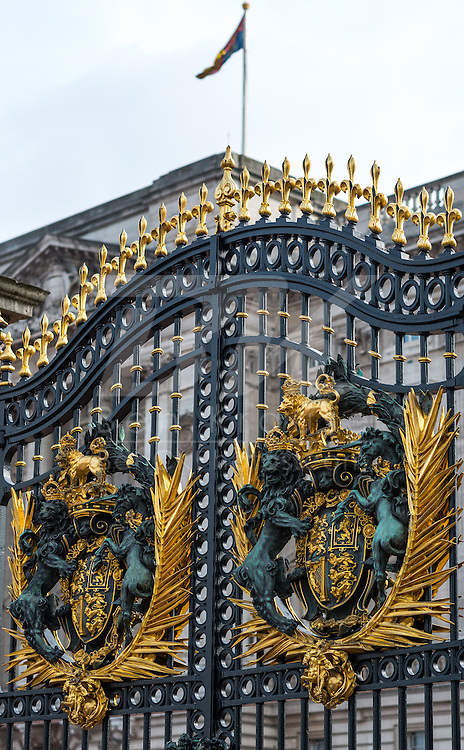 The gates to Buckingham Palace in London.  The flag above the palace indicates the Queen is home.
