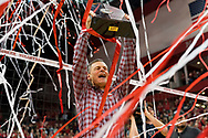 John Cook hoists the Big Ten trophy during a 3-0 win over Iowa to clinch a share of the Big Ten Championship at the Bob Devaney Sports Center in Lincoln, Nebraska on Nov. 25, 2017. Photo by Aaron Babcock, Hail Varsity