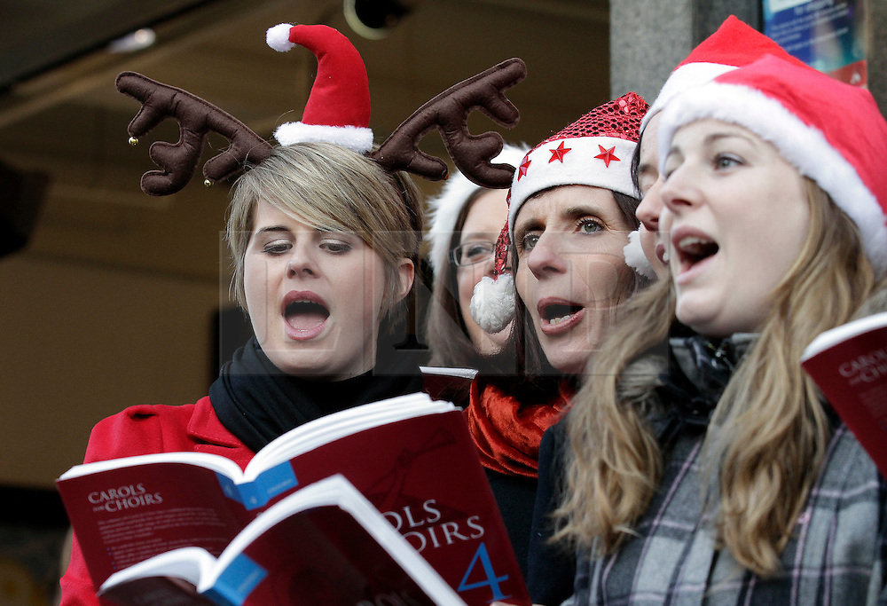 © Licensed to London News Pictures. 20/12/2011. London, United Kingdom .The Military Wives Choir sing to the public outside of HMV on Oxford Street to celebrate the success of their single..Photo credit : Chris Winter/LNP