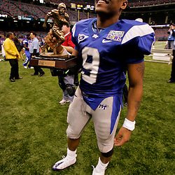 Dec 20, 2009; New Orleans, LA, USA; Middle Tennessee State Blue Raiders quarterback Dwight Dasher (9) holds the MVP Trophy following the 2009 New Orleans Bowl at the Louisiana Superdome. Middle Tennessee State defeated Southern Miss 42-32. Mandatory Credit: Derick E. Hingle-US PRESSWIRE