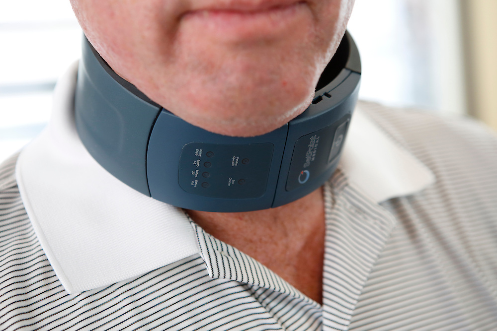 Mike Faltys. CTO of SetPoint Medical demonstrates wearing the inductive charging collar - which connects to the microregulator hybrid implant to charge the implant within the patients neck, as seen in Faltys' home on Friday, November 1, 2013 in Valencia, Calif. The regulator works by using electric stimulation to supplement the body's natural inflammatory reflex and reduce inflammation. The medical-device industry is being squeezed by a drought of venture capital that has made it harder to start companies and develop new products. <br /> CREDIT: Patrick T. Fallon for The Wall Street Journal<br /> Assignment ID: 28059 Slug: MEDDEVICE
