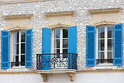 Medieval architecture, wrought iron balcony, shutters La Bastide Restaurant in 13th Century bastide town Eymet, Aquitaine France