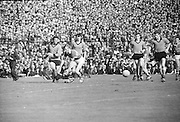 Kerry player failing in an attempt to catch the ball kicks the ball during the All Ireland Senior Gaelic Football Final Kerry v Down in Croke Park on the 22nd September 1968. Down 2-12 Kerry 1-13.