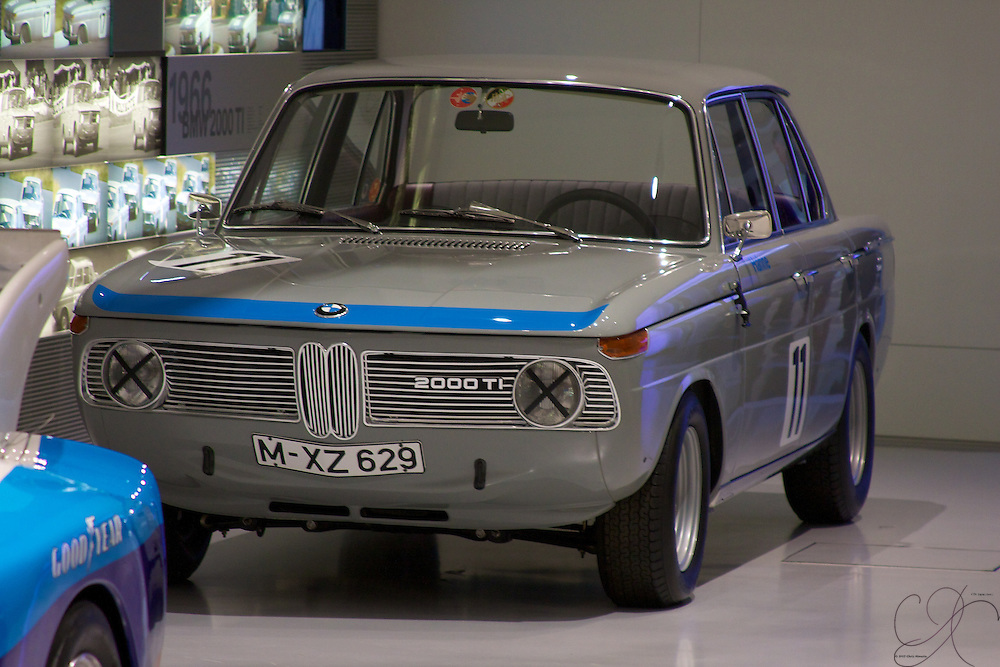 A 1966 BMW 2000 TI Rally car sits just behind a 1977 320 inside the Race/Rally car section of the BMW Musuem