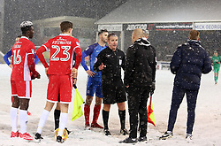 The match referee Mr L Swaby speaks to Walsall manager Jon Whitney as heavy snow interrupts play - Mandatory by-line: Joe Dent/JMP - 27/02/2018 - FOOTBALL - ABAX Stadium - Peterborough, England - Peterborough United v Walsall - Sky Bet League One